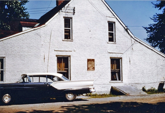 Plaque on the mansion, 1957. Photo from Brian Abbott website.